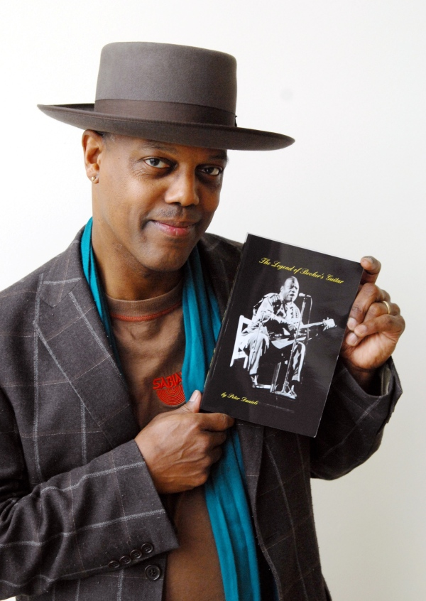 Eric Bibb, who plays a key role in The Legend of Booker's Guitar